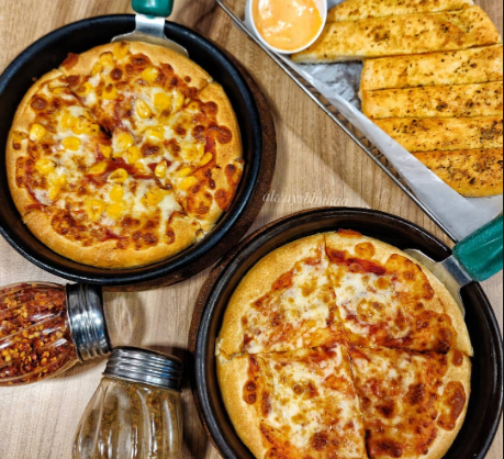 Everyday Value Offer - Select any 2 Regular Pizzas worth Rs 165 at Rs 99 each